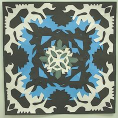 "This project is made just like paper snowflakes. First, we practiced folding and cutting a snowflake with pre-cut 8 1/2"" squares (2@)..."
