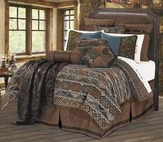 Rich earth tones add to the subtle Navajo inspired design featured on the Rio Grande Bedding. Luxurious and rustic, the collection offers the bedding as a set which includes duvet, pillow shams, euro shams, decorative neckroll and bed skirt and optional accessory pieces.