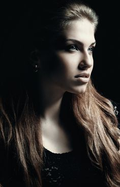 Nice portrait with black background.