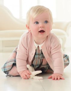 """""""This luxuriously soft cardigan in rose pink cashmere layers perfectly with our beautiful baby dresses. Featuring pretty pointelle knit diamonds and ribbed knit detailing, with baby-safe pearl-look buttons to complete the style. Cardigan Bebe, Baby Cardigan, Cute Kids, Cute Babies, Cute Baby Boy, Babies Stuff, Funny Babies, Pinafore Dress, Baby Safe"""
