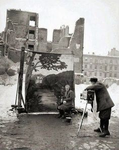 Michael Nash, Warsaw, 1946   A photographer uses his own backdrop to mask Poland's World War II ruins while shooting a portrait in Warsaw in...