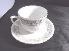 Antique Footed Tea Cup & Saucer China Floral Silver Trim