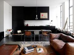 that leather couch looks like a slice of heaven.