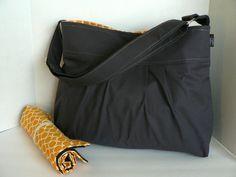 Monterey Medium Diaper Bag Set - Charcoal and Circles in Marigold - Adjustable Strap and Elastic Pockets. $95.00, via Etsy.
