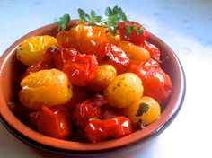 Roasted Cherry Tomatoes-- serve with sturdy bread and a soft cheese.