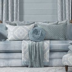 6. Blankets and Throws.  Throws are great way to add another layer or another pattern and they are practical. For a formal look fold neatly underneath/behind your cushion cluster. You can even create a layering effect by using more than one. Informal, drape casually over the arm of your sofa.