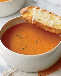 This grown-up version of a childhood fave, tomato soup with grilled cheese, is so simple to make and so delicious and unique thanks to the pimenton.