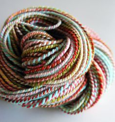 Pretty two-ply cord. would be cute wrapped around a can (for storage).