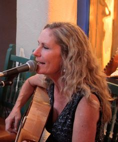 The lovely Kim Treiber! Taos local singing original classic country. Photo by Jim Cox