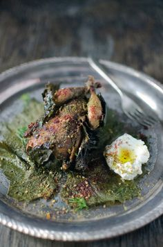 Quail smoked in vine leaves