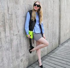 Shop this look on Kaleidoscope (top, clutch, vest, sunglasses, heels, skirt, necklace)  http://kalei.do/W8wCoRhH0iQxYHdE