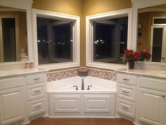 triangular corner tub, double vanity, double custom windows, custom tile surround