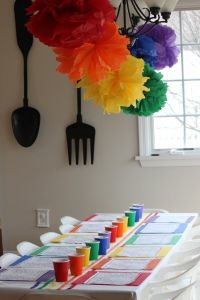 Care Bear coloring sheets and crayons sorted by color in matching cups.. love the rainbow pom-poms