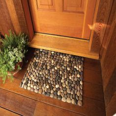 Glue Gun, Scissors, River Rocks at the dollar Store! and Shelf Liner (or mat) in a matching colour - outside front door as boot scrape