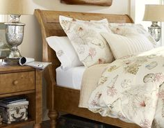 """I adore this bedroom. That wood tone is to die for! PB """"Seashore"""" duvet cover and shams. Mercury glass lamps. white sheets. pick-stitch quilt. (wood is kiln-dried spruce w/ light natural pine stain - Ashby Sleigh Bed PB). My dream room!!! @Dayna Wright"""