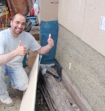 Removing the shuttering to expose a raw hempcrete wall
