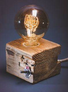Edison Lampe auf einem Holzblock mit Lichtschalter, Lampe im Industriedesign / industrial design for your home: light bulb on a wood cube made by lezakownia via DaWanda.com