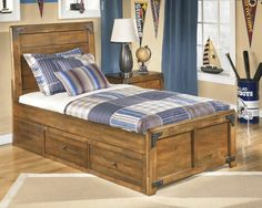 The rustic beauty of this twin panel bed comes with great storage for your son's room!