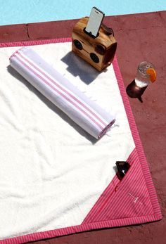 Poolside with ArteMare's Carry-All Towel outfitted with 2 quick-dry zip pockets.