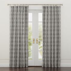 "British designer Genevieve Bennett looked to London's Chelsea neighborhood for inspiration for these sophisticated curtain panels. The white railing design is both intricate and graphic, tracing a streamlined grid on lined grey cotton. <a href=/rugs-and-curtains/curtain-hardware/1>Curtain hardware</a> also available.<br /><br /><NEWTAG/><ul><li>Designed by Genevieve Bennett</li><li>100% cotton curtain and lining</li><li>3"" rod pocket and 2"" bottom hem</li><li>Dry clean only</li><li>Made in…"