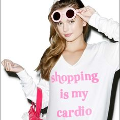 Wildfox 'Shopping is my Cardio' BBJ Size M  NWT/ in plastic packaging Wildfox Couture White V-Neck 'Shopping is My Cardio' written in pink. Size Medium. Please ask any questions you may have before purchasing    ✨No Trades/PP; Offers welcome through the offer feature✨ Wildfox Sweaters V-Necks