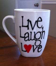 Live Laugh Love Hand Painted coffee mug All Coffee Mugs are made to order. Your design will be painted on an all white 12 ounce microwave safe porcelain coffee mug. I use an enamel paint and bake the mug for longevity. Please allow 3-5 business days for me to complete your order. All