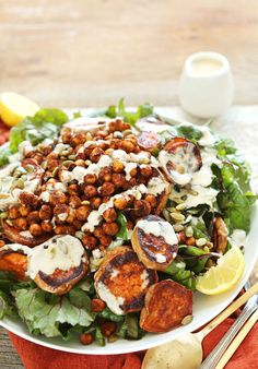 An amazing, hearty salad with swiss chard, roasted sweet potatoes, and crispy chickpeas with a creamy, tahini dressing. A healthy, plant-based meal.