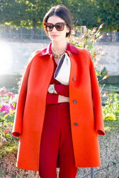 Colored falls. tangerine wool coat over a lipstick-red suit