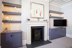Floating Shelves and Bespoke cabinets feature in this fitted alcove unit   www.creativewoodwork.co.uk