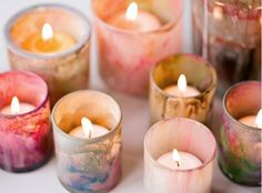 Watercolor votives...very easy to do for a D.I.Y. budget...all that's needed is clear votives, watercolor paints and water.  Woohlah!  Beauty by candlelight...