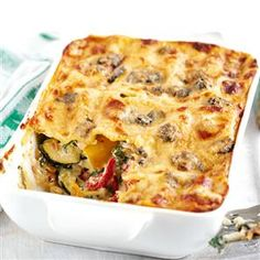 Summer vegetable lasagne with blue cheese and pine nuts recipe. This vegetarian lasagne recipe uses summer vegetables, including courgettes and roasted red peppers, for a tasty meat-free pasta bake.