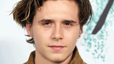 Brooklyn Beckham Gets Another Tattoo Continues Transformation into Dad David