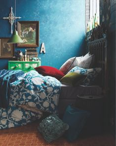 Moody Blue Bedroom. Love the turquoise wall with the green chest of drawers to accent it