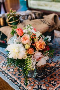 Peach wedding bouquet with peonies, tulips + greenery {Specialties Florals and Events}
