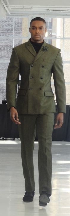 I don't typically go for double breasted coats but this is sharp! Darkoh Menswear dark green suit.