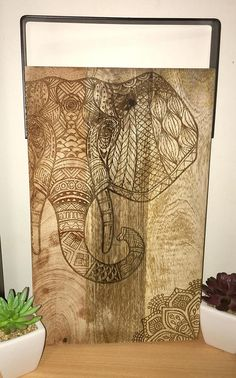 Items similar to Elephant Mandala design engraved onto a Mango wood chopping Board with Iron Handle on Etsy Wood Chopping Board, Cutting Boards, Graphic Design Projects, Design Ideas, Woodburning, Mandala Design, Board Ideas, Laser Engraving, Artsy Fartsy