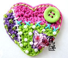 crocheted heart  This would look adorable as a pocket on a cardigan or an applique on a purse or scarf.