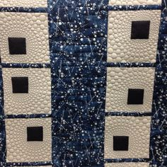 Circles in squares, quilted by Thornapple Quilting LLC