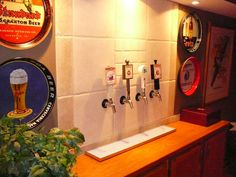 Basement idea...3 taps with a kegerator behind the wall