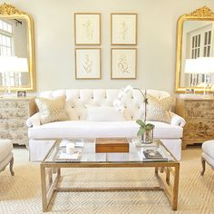 Munger Interiors - living rooms - glass and brass coffee table, white tufted sofa, white sofa, tufted sofa, gilt mirrors, french chests, diamond rug, Aloof Grey,