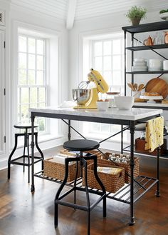 Elegant marble-top island translates French style into a timeless design that evokes the charm of an Old World pastry shop. Practical and beautiful, the white marble top sits on a classically inspired metal base.