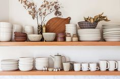 open wood shelves with ceramic dishware in kitchen / sfgirlbybay