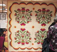There were several shows of antique quilts to see. One was Connie Nordstrom's Pot of Flowers exhibit. Connie has been collecting information about a special applique pattern.