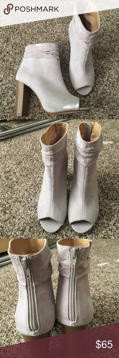 "Brand new Express booties! Stunning back zipper up grey booties from Express. Never worn purchased this past winter. They are a dove grey faux suede and medium brown ""wood"" heel. Express Shoes Ankle Boots & Booties"