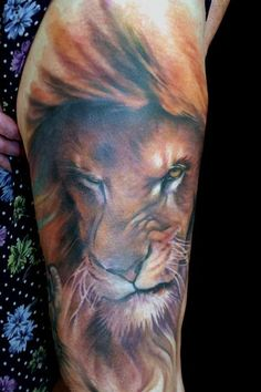 By all means I hate huge Tattoos but that is probably the best Lion Tattoo I have ever seen :)