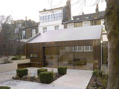 A West-London extension to a 1850s villa accompanied with timber clad annex with flush glazing by Pitman Tozer:  Click to see the project and follow Pitman Tozer here http://www.archello.com/en/project/lateral-house?a=follow #architecture #design