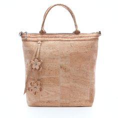 Elegant hand bag made of silky smooth cork leather. Sustainable, vegan. Available in 3 colors.