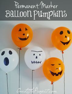 These permanent marker balloon pumpkin decorations are super cheap and easy to put together.  And when you are done, there is nothing to store!