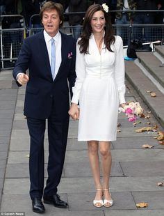 Paul & Nancy...Happy couple: The pair looked relaxed as they arrived ahead of their wedding