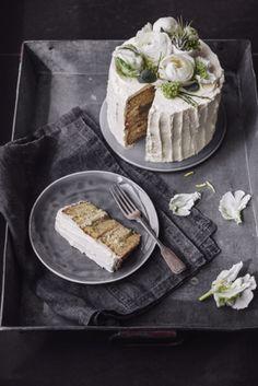egg liquer cake with rhubarb-vanilla jam, white chocolate-pistachio-ganache and pineapple frosting.